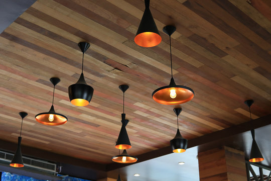 modern light lamp hanging interior decorative on wooden celling in cafe