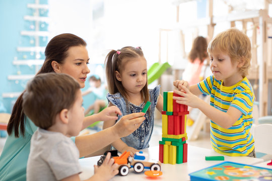 Little kids build block toys at home or daycare. Kids playing with color blocks. Educational toys for preschool and kindergarten children.