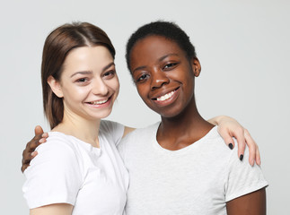 Multiethnic friendship concept. Cheerful European and African women.