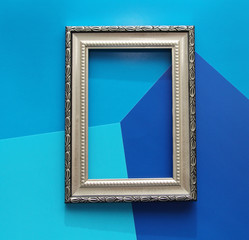 Vintage frame for photo, picture or certificate. There is nothing in the frame. Background in blue shades.