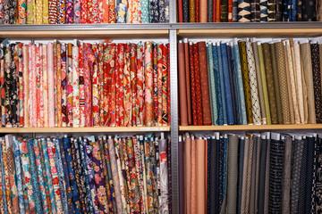 Fabric bolts on shop shelves