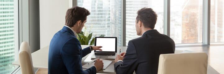 Horizontal rear image businessmen analyzing market pointing on computer screen