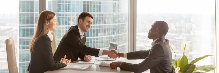 Horizontal image african boss congratulate business partner with successful negotiations