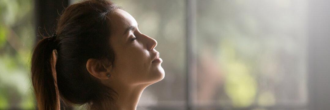 Side view beautiful woman with closed eyes enjoying fresh air