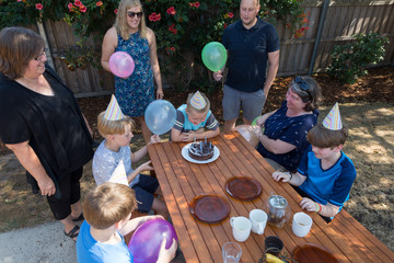 A backyard birthday party photographed from a high vantage point.