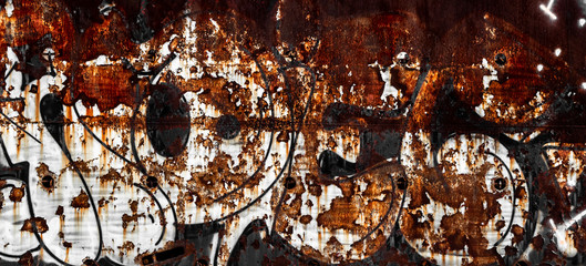 Rusty wall with graffito