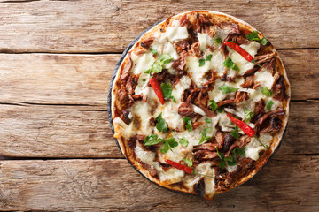 Fresh pizza with pulled pork, mozzarella cheese, chilli and barbecue sauce close-up. horizontal top view Wall mural
