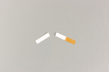 Paper cigarette cutout torn in halves for quit smoking concept