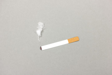 Paper cigarette with smoke made of cotton