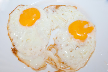 scrambled eggs from two eggs on a white background