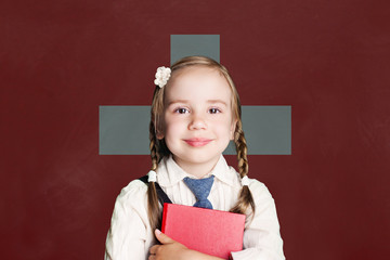Switzerland concept with little girl student with book against the Swiss flag background