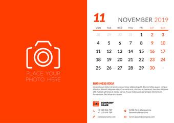 November 2019. Desk calendar design template with place for photo. Week starts on Monday. Vector illustration