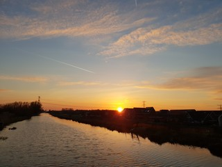 Sunset over the ring canal along the Bermweg in Nieuwerkerk aan den IJssel in the Netherlands