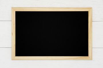 Blank chalkboard on white wood plank background.
