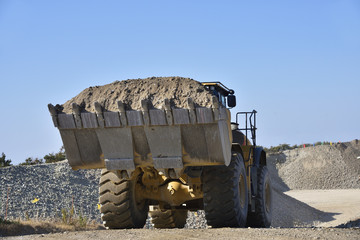 Wheel loader carrying large amounts of earth and sand