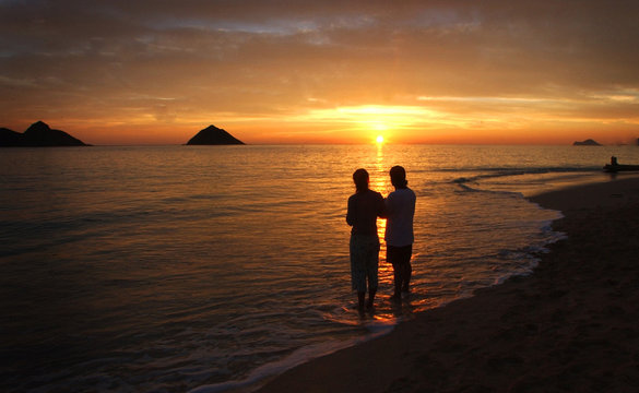 Minnesota couple watch tropical sunrise at the Mokula Islands bird sanctuary in Hawaii.