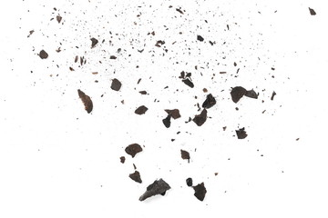 Burned and charred paper scraps isolated on white background, top view