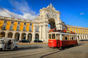 Touristic tram at Praca do Comercio (Commercial Square) near Triumphal Arch of Rua Augusta. Sunny day in famous tourist place of Lisboa Wall mural