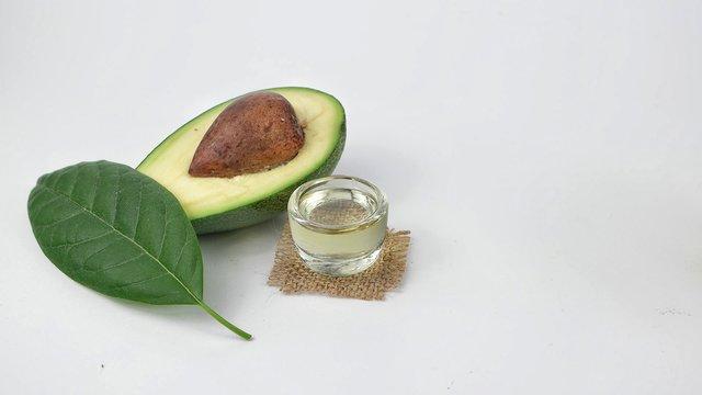 Avocado fruit, avocado leaf and avocado oil on a white background