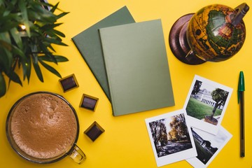 Coffee mug globe photo yellow background green notebook keyboard instant camera cards free space plants chocolate