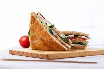 Club sandwich, with tomato, lettuce and cheese on white background