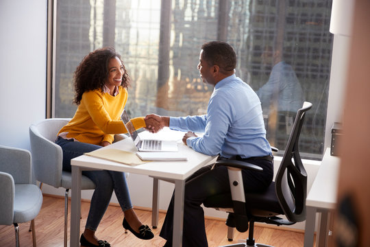 Woman Shaking Hands At Meeting With Male Financial Advisor Relationship Counsellor In Office