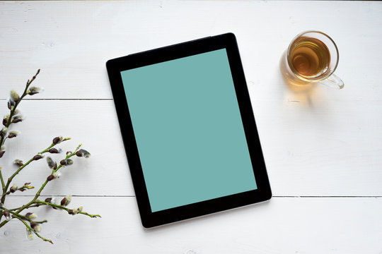 Work morning mood mock up for your text and design, top view, flat lay, white planchet with willow branch and tea at rustic wooden background.
