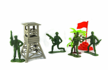 Group of Miniature hold gun toy soldier isolated on white background