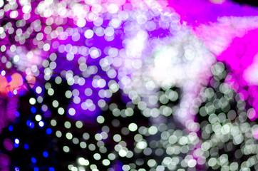 Colorful blur bokeh fairy street light festival, night defocused & dark background.