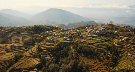 Village in the Himalayas. Aerial View: Flight over the mountains Himalayas, of Nepal