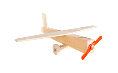 Wooden toy airplane isolated on white, as air transport concept