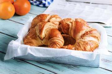 Croissant for breakfast on wooden surface