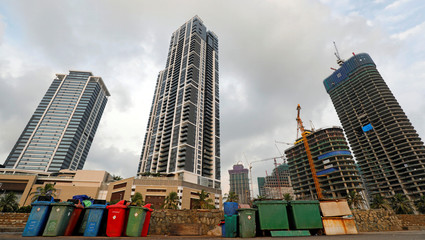Garbage bins are seen in front of the luxury hotels and apartment buildings in Colombo