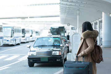 Tourist is wating for Taxi in front of the Air Port in Tokyo, Japan.