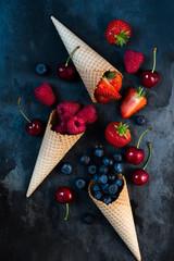 fresh fruits in ice cream cones