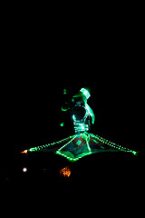 ABUDHABI/UAE - 17 DEZ 2018 - Traditional Arabic dance in Abu Dhabi, man dancing with dark environment and suit with green lights.