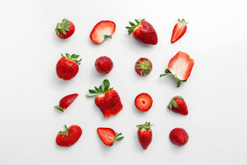 Strawberry pattern on a white background, creative flat lay healthy food concept, top view