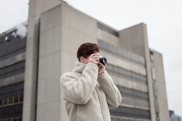Man taking picture with camera outdoors