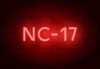 NC-17 rating sign. Vector neon sign on brick illuminated wall