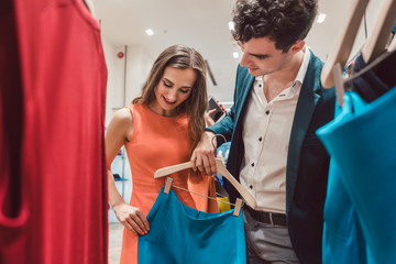 Couple craving for new clothes in fashion shopping spree