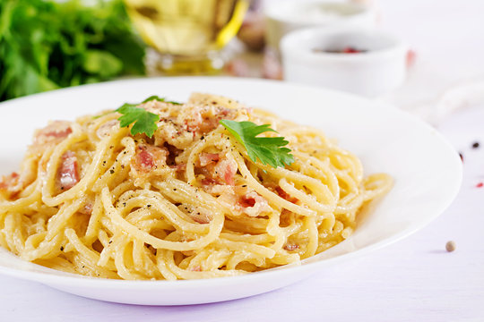 Classic homemade carbonara pasta with pancetta, egg, hard parmesan cheese and cream sauce. Italian cuisine. Spaghetti alla carbonara.