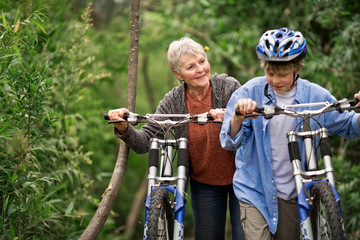 Grandmother and grandson cycling together
