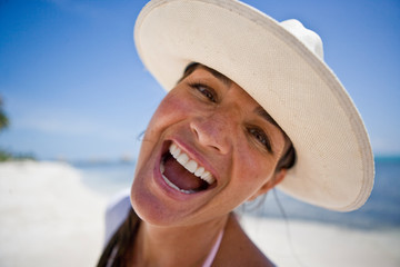 Portrait of a mid-adult woman standing in a beach.