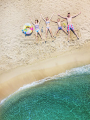Happy family having fun in the summer leisure. Aerial drone bird's eye view photo.