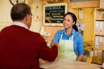 Sales clerk shaking hands with customer