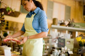 Sales clerk in store holding napkin