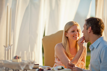 Smiling mid adult couple having a romantic dinner.