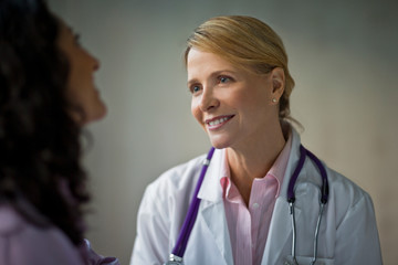 Smiling doctor speaking with colleague