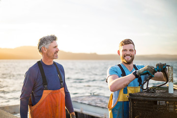 Father and son operating fishing business.