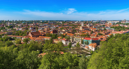 Wall Mural -  Vilnius city with tiled roofs cathedrals and churches modern buildings on the horizon